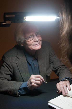 U. S. Poet Laureate W. S. Merwin signs books after his reading at the Harry Ransom Center. Photo by Pete Smith.