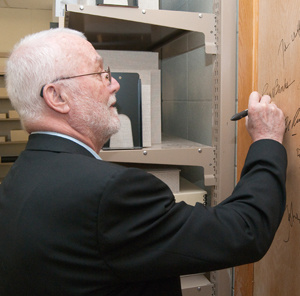Writer Russell Banks signs the authors' door. Banks's archive resides at the Ransom Center, which contains items ranging from essays on music icons Billie Holliday and Robert Johnson to his unpublished first novel 'The Locus.' Photo by Pete Smith.