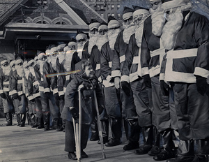 Twenty of Santa's helpers attend a March of Dimes Christmas party for Patricia Reilly and the Volunteers of America at the Tavern-on-the-Green. New York Journal American collection.