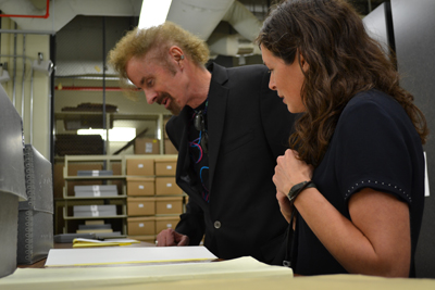 T. C. Boyle tours the Ransom Center with Megan Barnard, Assistant Director for Acquisitions and Administration. Photo by Alicia Dietrich.