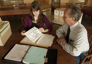 Archivist Carly Dearborn and Ransom Center Curator of Film Steve Wilson with materials from the Tom Smith collection. Photo by Pete Smith.