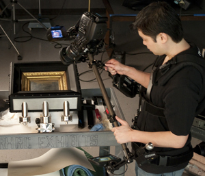 Multimedia Coordinator Lee Tran videotapes the First Photograph for an ongoing kiosk project. Photo by Daniel Zmud.