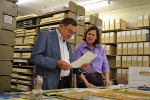 Mary Alice Harper, head of photography and art cataloging, shares new David Douglas Duncan materials with Ransom Center Director Thomas F. Staley. Photo by Alicia Dietrich.