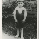 """A photograph of Ray Bradbury, age three. Bradbury spent most of his childhood in Waukegan, Illinois, a small community on the western shore of Lake Michigan. Waukegan became the model for the """"Green Town"""" that was the setting for many of his stories. As a boy Bradbury enjoyed fairy tales, horror movies, traveling carnivals, and visiting the local public library, and aspects of each of these interests would influence his later books and characters. Alfred A. Knopf collection."""