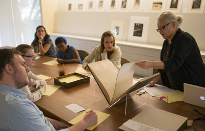 "Dr. Sherre L. Paris, a lecturer at The University of Texas at Austin's School of Journalism, teaches the undergraduate class ""A Cultural History of Photography"" at the Ransom Center. Photo by Pete Smith."