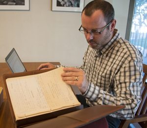 R. Colin Tait works with papers in the Robert De Niro archive in the Ransom Center's reading room. Photo by Pete Smith.