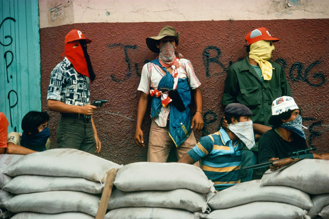 "Susan Meiselas. ""Nicaragua. Matagalpa. Muchachos await the counterattack by the National Guard."" 1978 © Susan Meiselas/Magnum Photos."