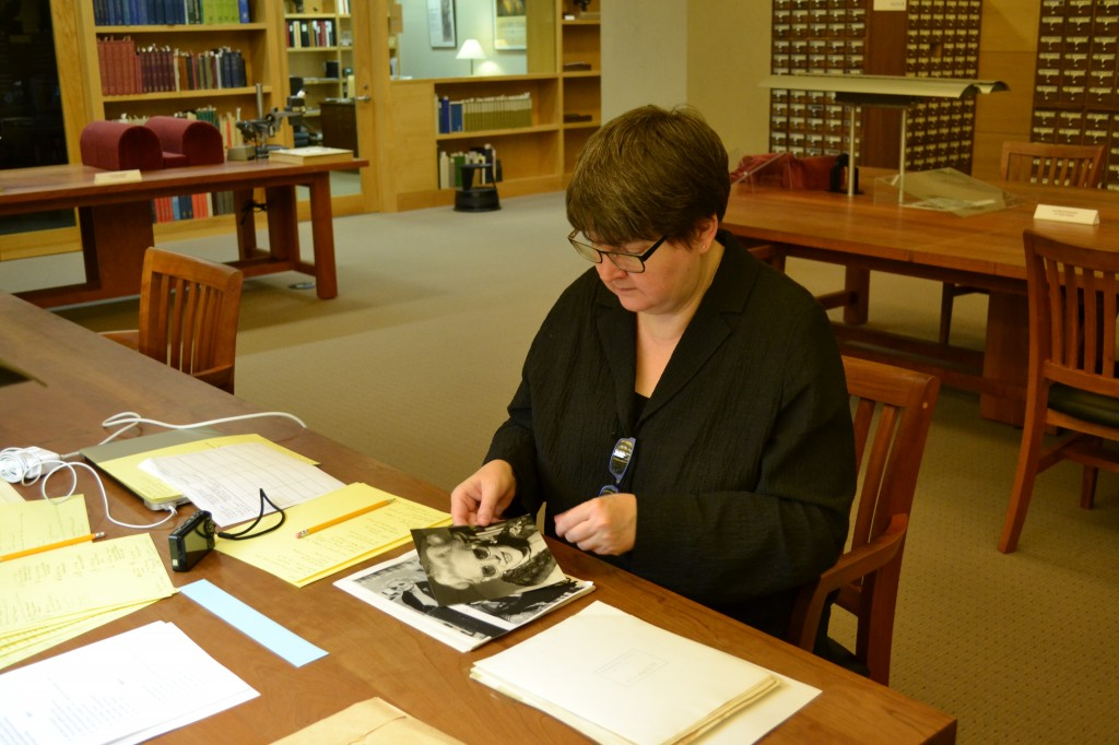 Scholar Teal Triggs works with materials in the Fleur Cowles archive in the Ransom Center's Reading Room. Photo by Alicia Dietrich.