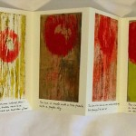 """""""Sun"""" accordion book opened to show a series of monoprints."""
