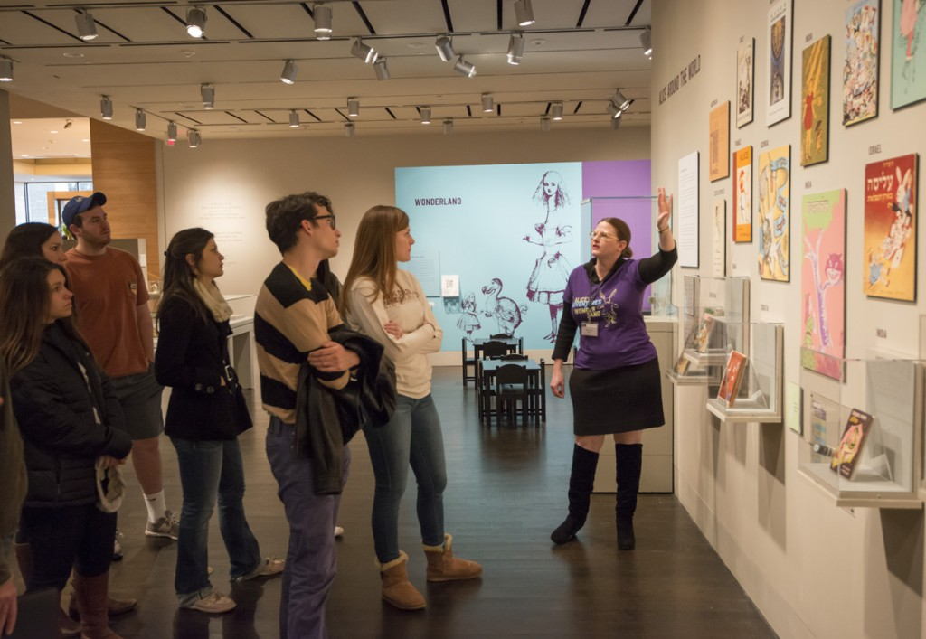 """Students in """"Advertising and Popular Culture"""" class receive tour of """"Alice's Adventures in Wonderland."""" Photo by Pete Smith."""