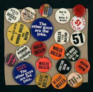 Buttons from Mailer's mayoral campaign.