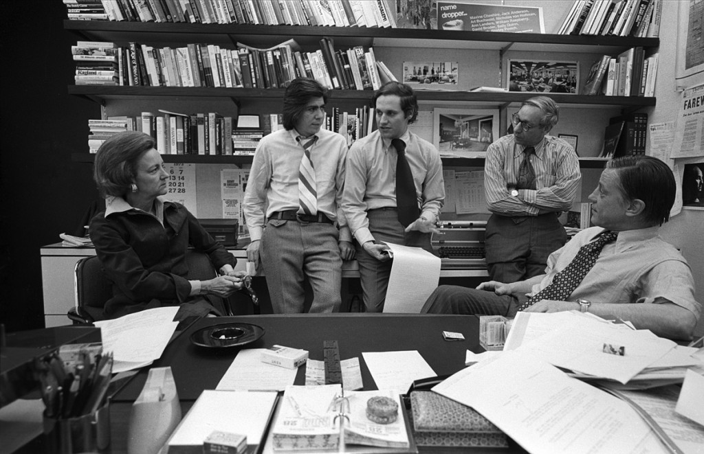 Washington Post publisher Katharine Graham with reporters Carl Bernstein, Bob Woodward, editor Howard Simons discuss the Watergate story in Post managing editor Benjamin C. Bradlee in Bradlee's office at the Washington Post, April, 1973.