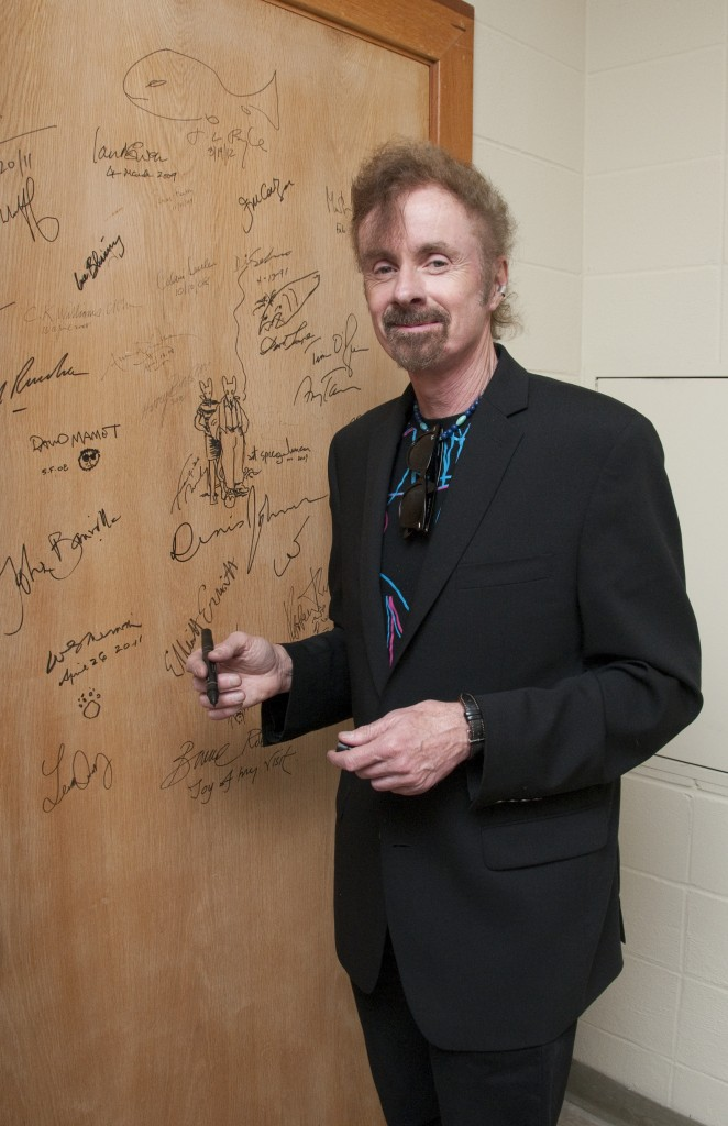 Author T.C. Boyle and the Ransom Center's authors' door. Photo by Pete Smith.