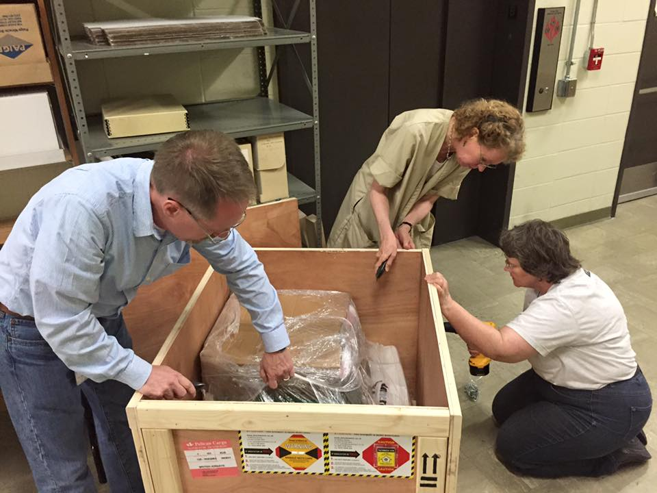 Ransom Center staff unload a recently arrived box of materials of the Dame Edith Evans collection.
