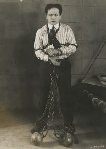 Unidentified photographer, [Harry Houdini in a publicity photo for his silent film The Grim Game], 1919. Gelatin silver print, 20.3 x 25.4 cm.