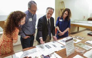 Curator of Film Steve Wilson shares recent acquisitions at the New Member Open House. Photo by Brian Diggs.