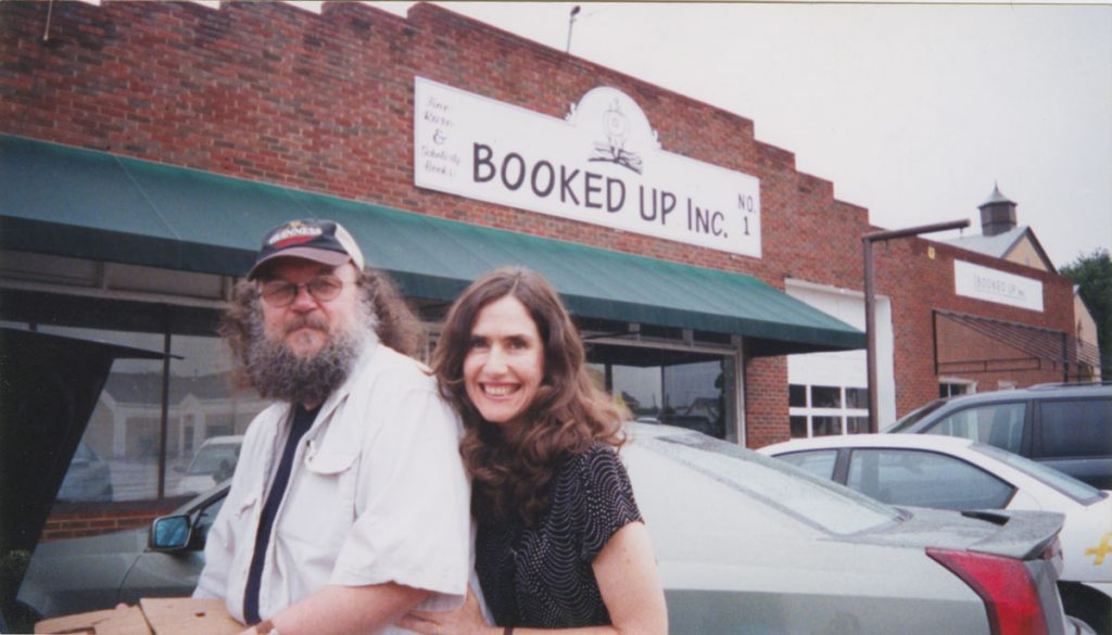 Michael Gilmore and his wife outside of Larry McMurtry's bookstore Booked Up, Inc. in Archer City, Texas.