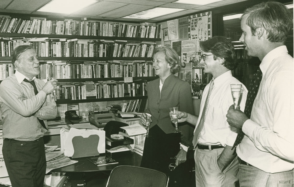 Ben Bradlee in his office at The Washington Post with Katharine Graham, Patrick Tyler, and Boisfeuillet Jones Jr., 1983.
