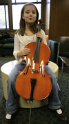 A student with a cello her size