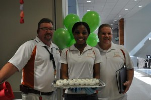 SAC staff John Morgan, Sarah Odion-Esene & Wade Raquet celebrate SAC's second birthday.
