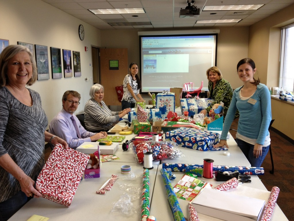 CMHC staff wrapping gifts for CPS Partnerships for Children campaign