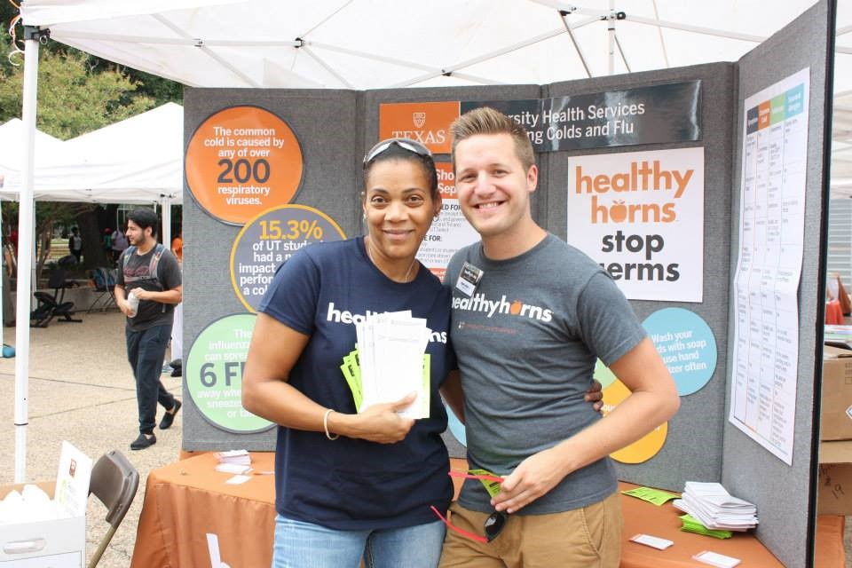 Erika Holmes and Ryan LaDue hand out information about preventing colds and flu at UHS' annual Healthyhorns Fest event