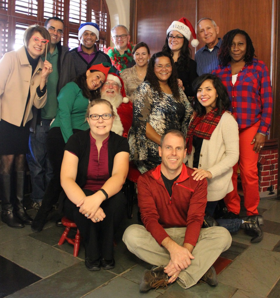 University Unions staff with Santa in the Texas Union
