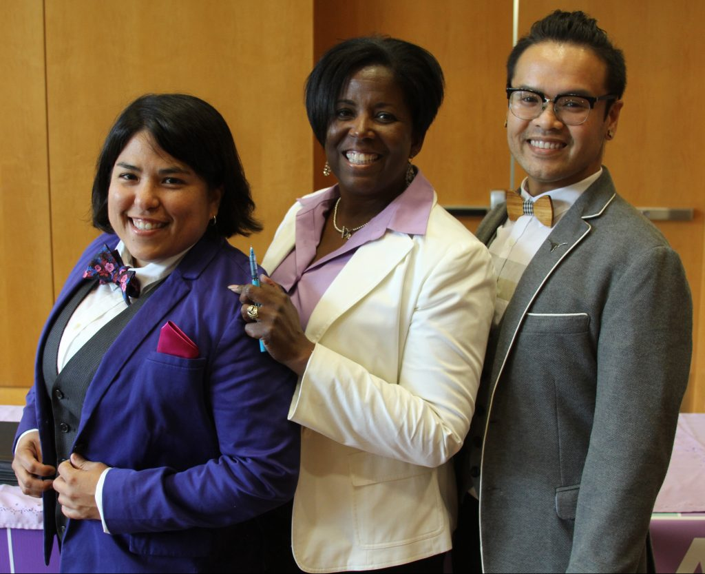 Elisa Ramos (Office of the Dean of Students), Soncia Reagins-Lilly (Office of the Vice President for Student Affairs) and Tony Vo (Division of Diversity and Community Engagement) at Lavender Graduation in the Student Activity Center