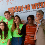 President Fenves poses with staff at Mooov-In