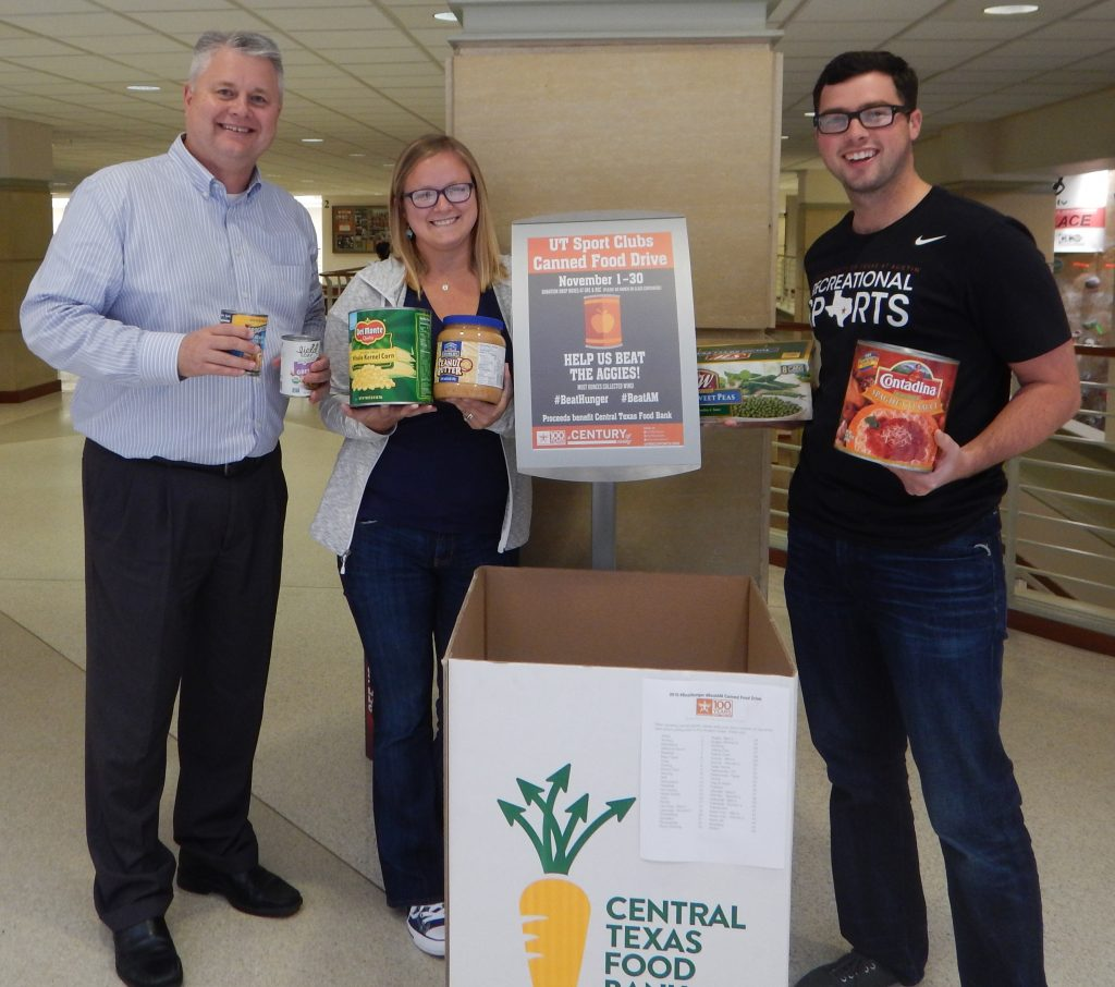 Randall Ford, Hannah Covington and Chad Zimmerman display some of the canned goods donated for the #BeatHunger, #BeatAM food drive.