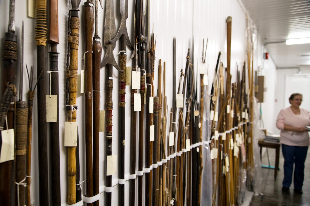 Marybeth Tomka, Head of Collections, providing a tour of the collections, including these spears in the ethnographic collection, for The Alcalde.