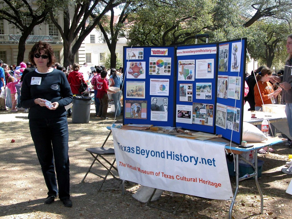 "This is Susan ""Too Cool for School"" Dial manning her Texas Beyond History table.  Explore UT, 2007."