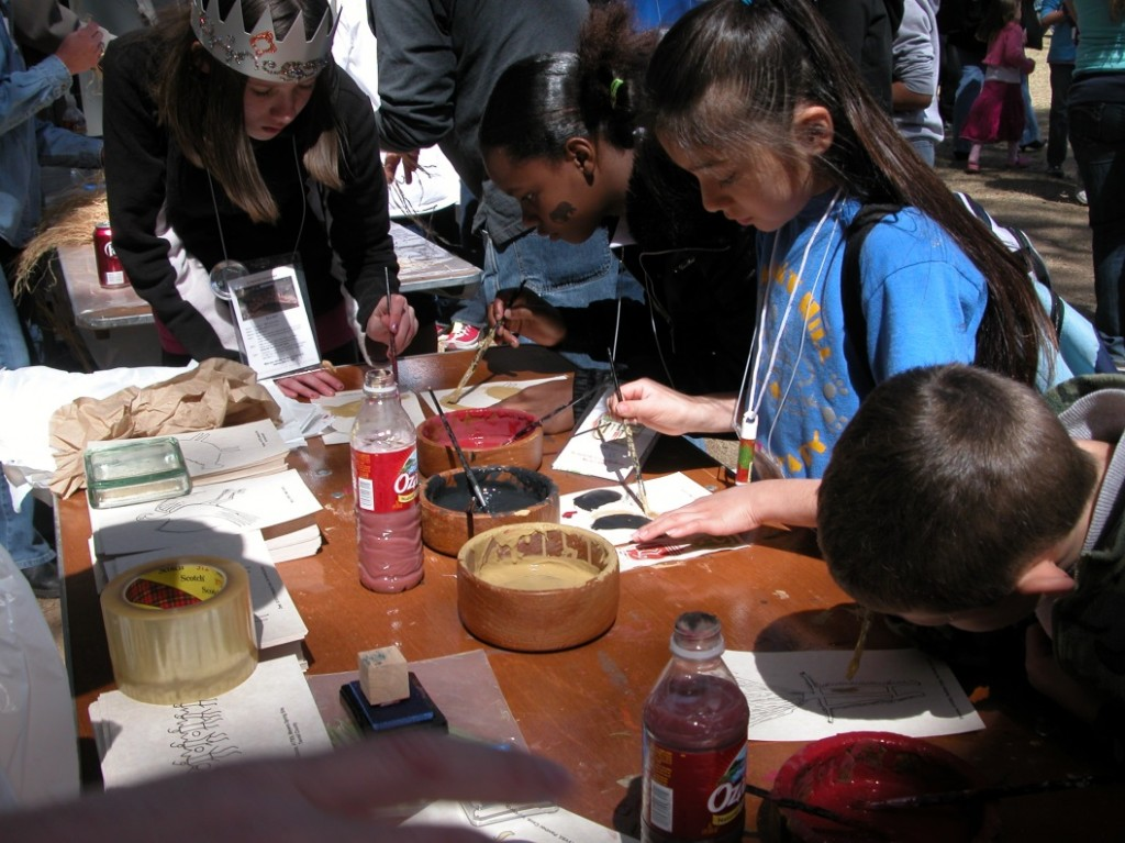 Kids (and staff) enjoying rock art painting during previous Explore UT event.