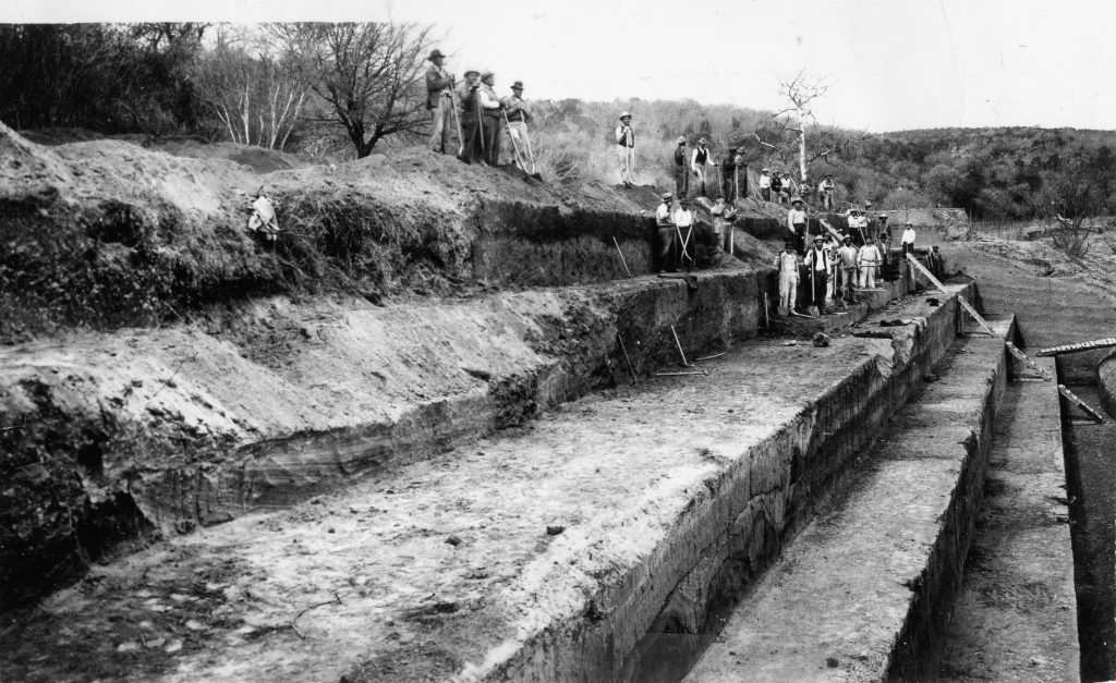 View of the stepped profile excavation at the Rob Roy Site, 41TV41, in 1939. The excavations recovered a sizeable collection o f lithic artifacts and faunal remains, including the remains of several bison which were butchered near the campsite.