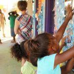 Mart residents working on an art mural