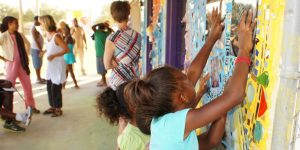 Mart residents working on an art mural