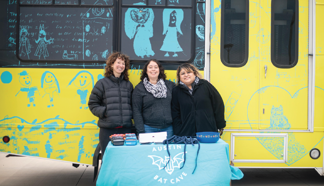 Heather Jones (left), ABC regional program manager Leticia Urieta (middle) and LEAD Coordinator Maria Allen (right) pose for a photo in front of the Bat Mobile at Del Valle High School on Oct. 11, 2019. Urieta organizes and runs the Bat Mobile program.