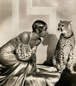 Image of Josephine Baker posing with her pet cheetah