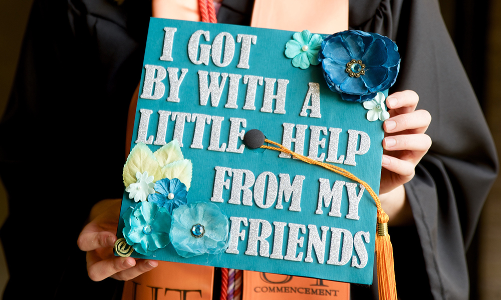 "Nursing graduation hat that says ""I got by with a little help from my friends."""