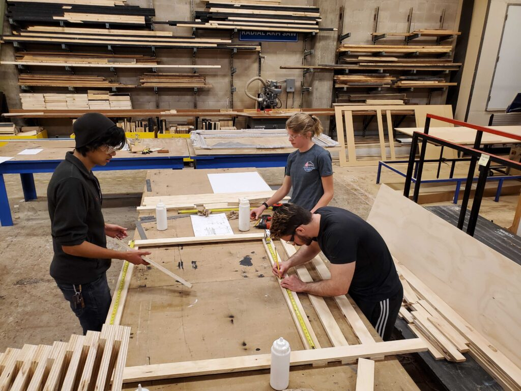 Students building signs