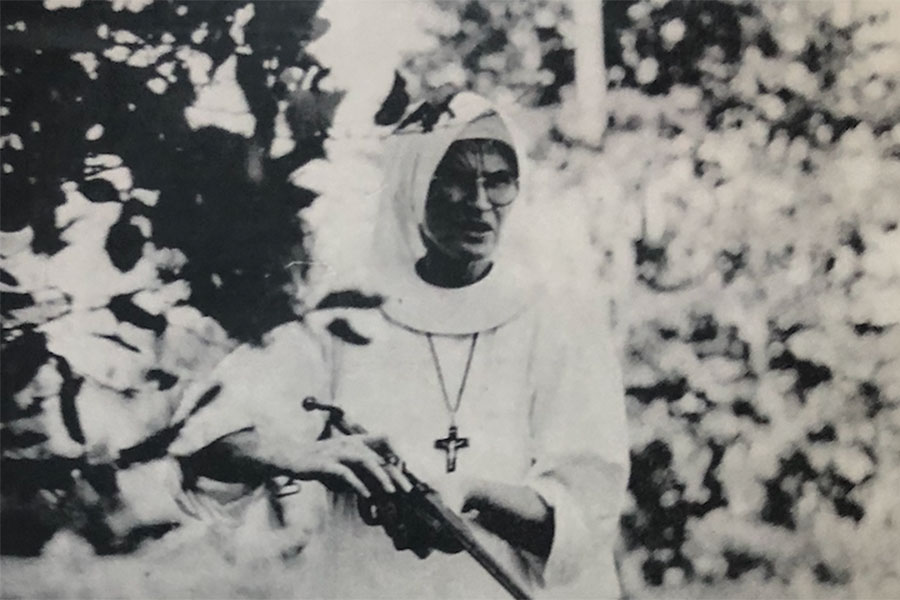 historic photo of nun holding a rifle