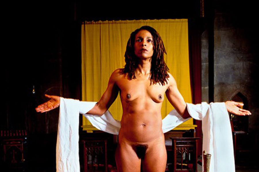naked woman in front of altar