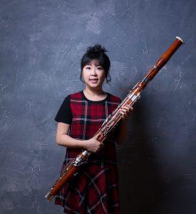 BSom Alumna Shih-Min Tang holding a bassoon