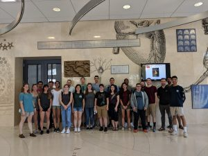 photo of the group of students and graduate students all together in the building lobby