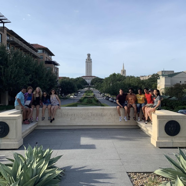 students in front of UT tower from the south mall