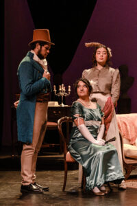 Maria sits in a chair while Mr. Rushworth stands by her side and Aunt Norris looks on