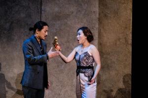 Donna Anna holds a gun while she and Ottavio sing