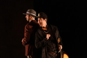 Giovanni stands back to back with Leporello and whispers