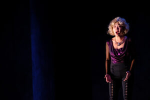 Elvira stands as she sings an aria