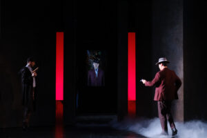 Commendatore is revealed standing between two red lights